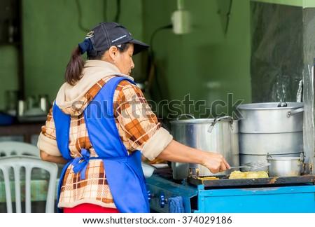 Banos De Agua Santa,  Ecuador- November 29,  2014: Latin Woman Cooking On The Streets Of South America - stock photo