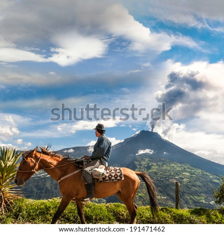 BANOS, ECUADOR - DECEMBER 10: Unrecognizable farmer looking at the  Tungurahua volcano eruption - december 10, 2010 in Banos, Cordillera Occidental of the Andes of central Ecuador, South America  - stock photo