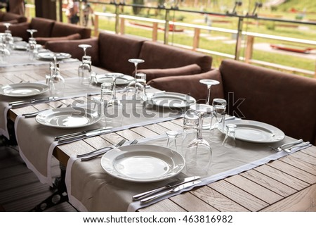Banquet hall. Beautiful restaurant. Laid table. Table setting. Restaurant interior