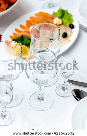 Banquet table decorated with glasses - stock photo