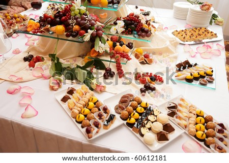 Banquet table full of fruits and berries - catering event, wide angle shot