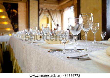 Banquet table in the restaurant, the preparation before the banquet - stock photo