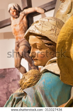BANSKA STIAVNICA, SLOVAKIA - FEBRUARY 5, 2015: The detail of carved statue of Madonna (Flight to Egypt sculptural group) as the part of baroque Calvary from years 1744 - 1751 by Dionyz Stanetti. - stock photo