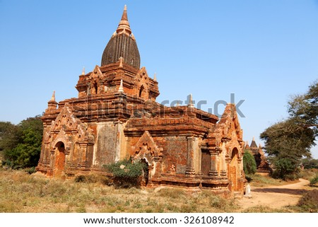 Banteay Srei - 10th century Cambodian temple dedicated to the Hindu god Shiva, located in the area of Angkor in Cambodia. It is built largely of red sandstone. - stock photo