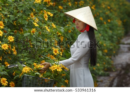 the focus on the lonely and beautiful path in the asian traditions Asian woman travel alone  beautiful scenery of the woman standing alone on a wooden pier looking at colorful clouds in the  concept of lonely, sad, alone,.