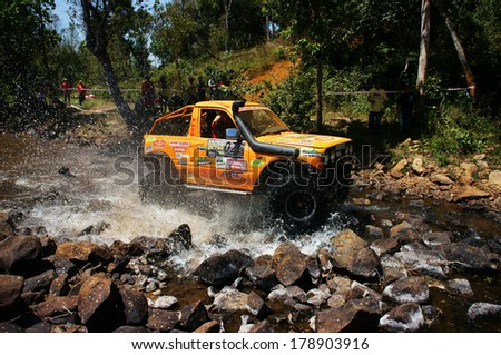 BAO LOC, VIETNAM- FEB 24, 2014: Racer at terrain racing car competition,motor cross stream that extreme off road with rock on water, competitor  adventure in championship spirit, Viet Nam - stock photo