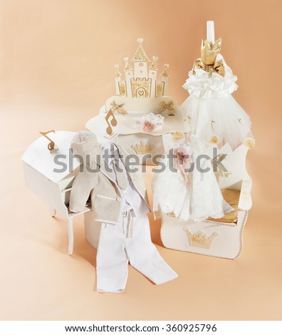 baptism clothes and accessories on a beautiful composition in studio  - stock photo
