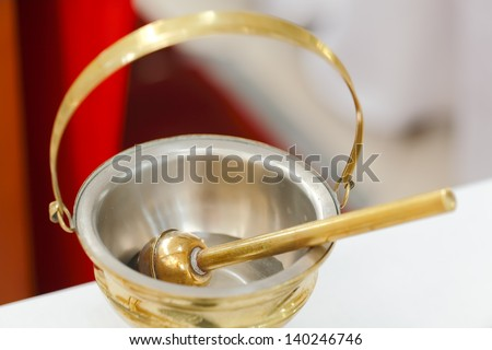 Baptismal objects - Holy Water Pot and Holy Water with Sprinkler - stock photo