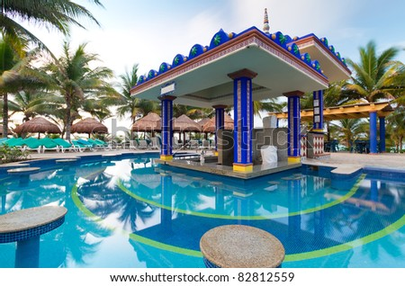Bar at tropical swimming pool in Mexico - stock photo