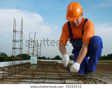 Bar bender fixing steel reinforcement for house concrete floor slab - stock photo