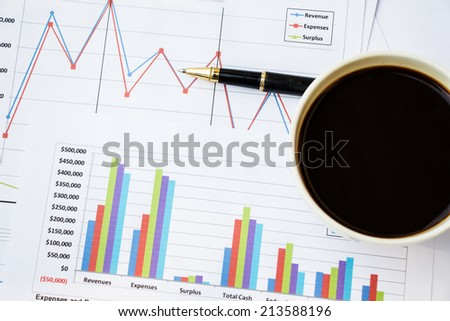 Bar charts and pen as accounting or business concept - stock photo
