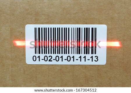 bar code with laser on carton box - stock photo