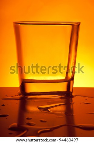 Bar glass on an orange background