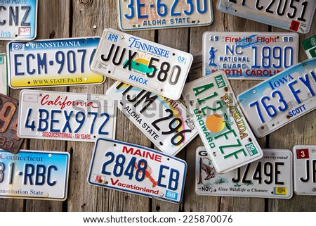 BAR HARBOR, MAINE - AUGUST 28: Old car license plates on a wall in Bar Harbor. In the United States, each jurirsdiction has a unique design, usually displaying symbols of the issuing state. August 28 2014 - stock photo