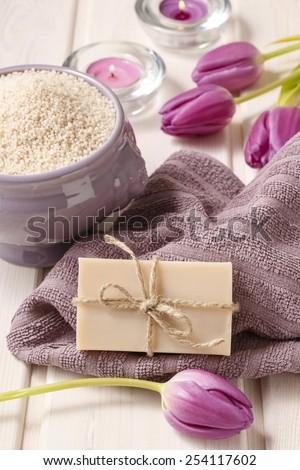 Bar of natural handmade soap and bowl of lavender sea salt - stock photo