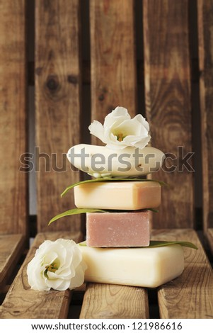 Bar of soap and spa treatment - stock photo