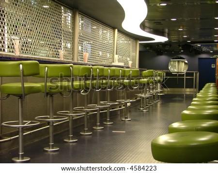 bar seats and a curvy light - stock photo