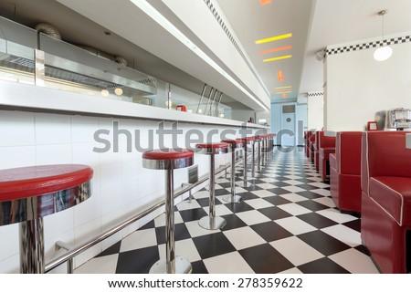 bar stools in restaurant diner - stock photo
