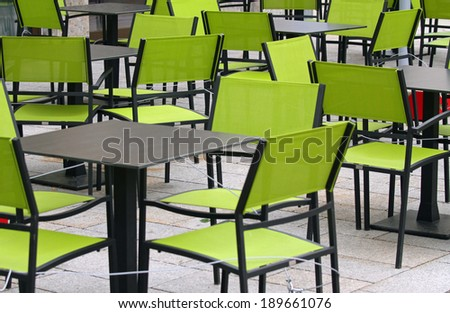 bar with green chairs and tables outdoors