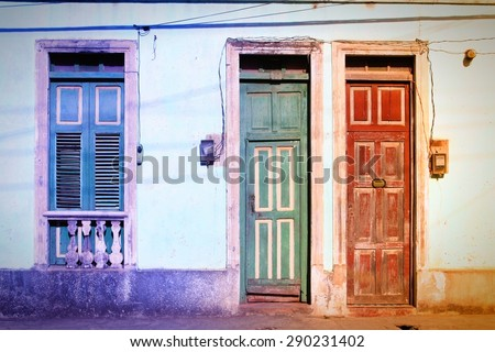 Baracoa, Cuba - colonial architecture. Colorful street view. Filtered colors. - stock photo