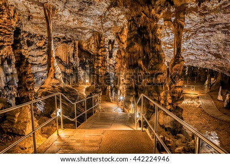 Baradle Cave in Aggtelek National Park in Hungury. Stalactite and stalagmite inside a cave - stock photo