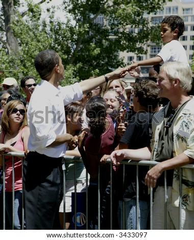 Barak Obama shaking hands in Reno - stock photo