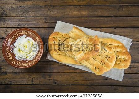 Barbari or Persian bread with strained yogurt, greek yogurt, yogurt cheese or labneh - stock photo