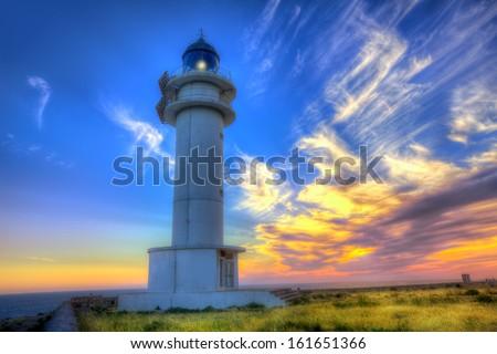 Barbaria Berberia Cape Lighthouse Formentera at sunset in Balearic Islands - stock photo