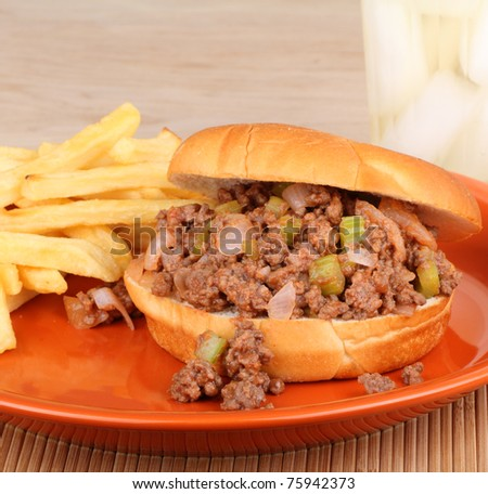 Barbecue beef sandwich on a bun with french fries