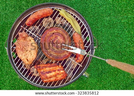 Barbecue Charcoal Hot Grill With Various Kinds Of Meat,  Outdoor Summer Picnic Or Party Concept - stock photo