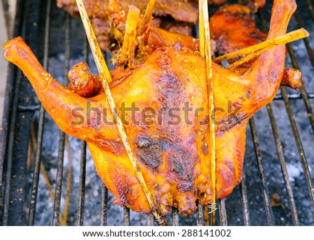 Barbecue Chicken grilling, cooking food Vietnam. - stock photo