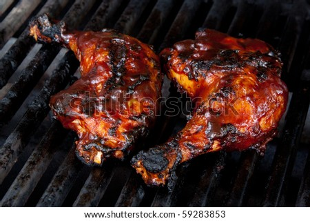 Barbecue Chicken Leg Quarters on Grill with Sauce - stock photo