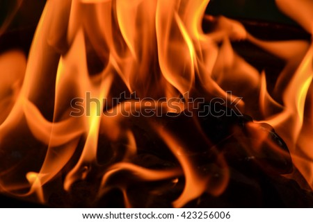 Barbecue flame against black background