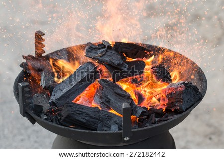 Barbecue grill, charcoal and Flames of Fire - stock photo