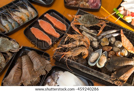 Barbecue Grill cooking seafood on hot fire ,barbecue seafood buffet,eat restaurant
