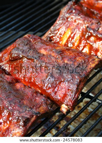 Barbecue pork ribs on a grill - stock photo