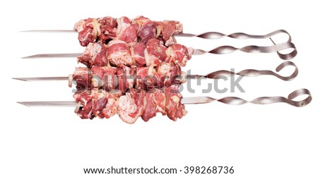 barbecue, raw juicy slices of meat on skewers with sauce isoleted on white - stock photo