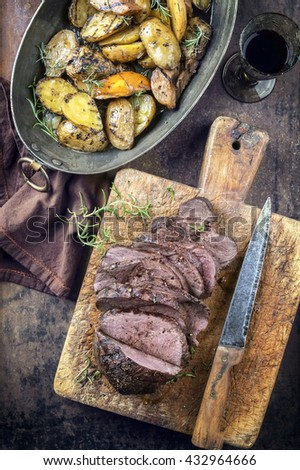 Barbecue Roast Venison with Potatoes and Quince - stock photo