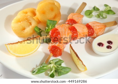 barbecue salmon on a skewer on plate - stock photo