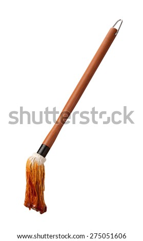 Barbecue Sauce Basting Mop with a Wooden Handle. This cooking utensil is a cut out, isolated on a white background.