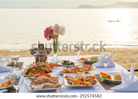barbecue seafood for dinner by the sea, sunset