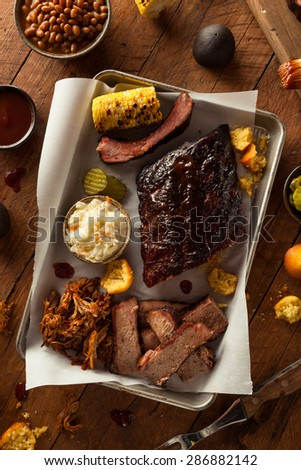Barbecue Smoked Brisket and Ribs Platter with Pulled Pork and Sides - stock photo