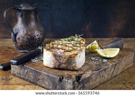 Barbecue Swordfish Steak on Chopping Board - stock photo