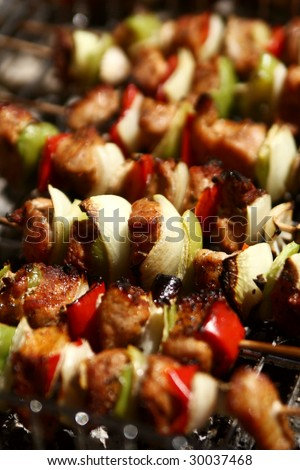 barbecue with delicious grilled meat on grill - stock photo