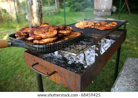 Barbecue with Steaks - stock photo