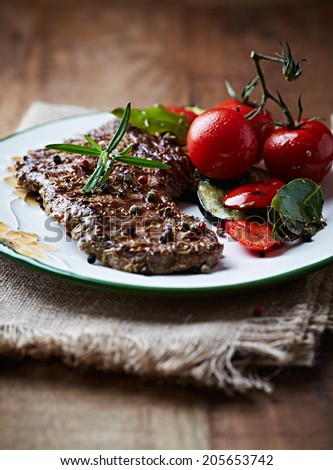 Barbecued Beef with Herbs and Cherry Tomato - stock photo