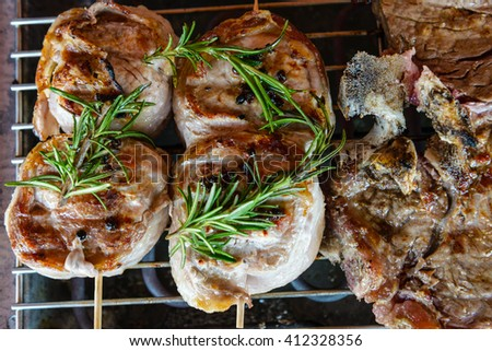barbecued meat seasoned with olive oil and rosemary - stock photo