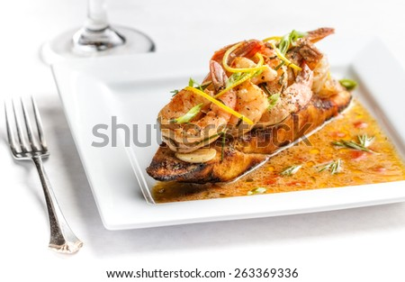 Barbecued shrimp on crusty bread - stock photo