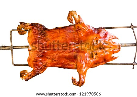Barbecued suckling pig on white background - stock photo