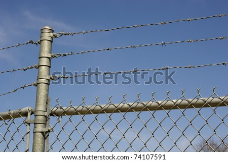 Barbed Wire Chain Link Fence - stock photo